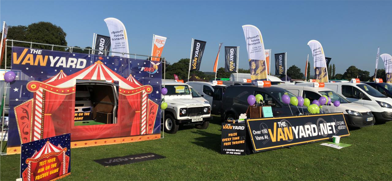 The Van Yard displaying vans at a local show